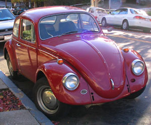 1967 VW Beetle with missing bumpers, left-side horn grill; this was the final year in the U.S. for the old bodystyle incorporating the updated headlights sourced from the Type 3.