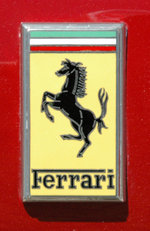 The Ferrari Gestione Industriale badge on the front of a 330 GTC