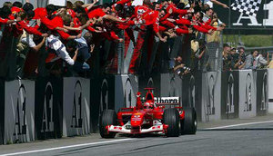 The Scuderia celebrate another Schumacher win, (C) Ferrari Press Office