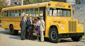 The school bus yellow paint was shining brightly on this new 1973 International Harvester - Wayne Lifeguard school bus won in a national contest for safety ideas. The bus is shown being presented to the  winning driver from Goochland County Public Schools at the Virginia State Capitol